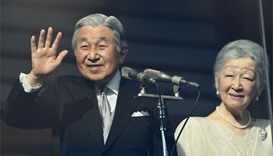 Huge crowds cheer Japanese emperor on 83rd birthday