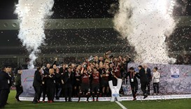AC Milan's players celebrate winning against Juventus during the Italian Super Cup final match
