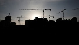 A construction site is silhouetted in the Israeli settlement of Har Homa
