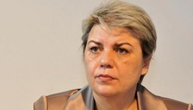 Romania's first female, Muslim PM rejected