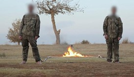 An image grab from a video that purportedly shows the soldiers before being burned alive