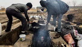 Images of homeless living in graves shock Iran