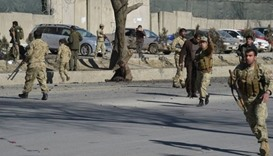 Afghan security personnel gather at the site of the bomb attack