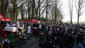 Horns blare as Polish truck driver buried