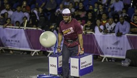 Champion Fahad al-Haddad walks 20 metres while holding 180kg in less than 10 seconds.