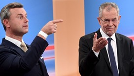 Austrian far-right candidate Norbert Hofer (L) and his rival Alexander Van der Bellen