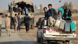 Iraqi families, displaced from the city of Tal Afar, arrive on trucks in the village of Tall al-Zark