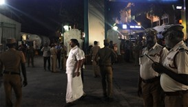 Indian policemen stand in front of a hospital where Jayalalitha is treated