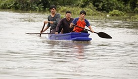 Rescue workers search for two missing boys who went missing during a flash flood