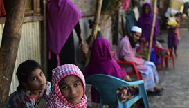 Myanmar Rohingya refugees look on in a refugee camp in Teknaf, in Bangladesh