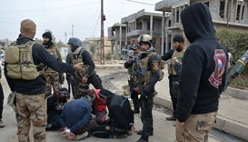 Handcuffed men, who according to the Iraqi security forces are suspected IS militants- east of Mosul