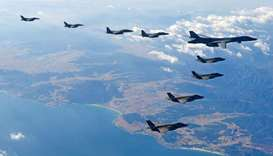 US Air Force B-1B bomber flies in formation during a joint aerial drill called 'Vigilant Ace' betwee