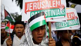 Protesters hold a rally outside the US embassy in Jakarta, Indonesia, to condemn the US decision to