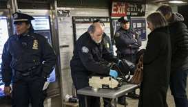 Members of the Transportation Security Administration and New York City Police Department check the