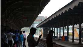 Sri Lankan passengers wait for trains at the Fort railway station during a nationwide railway strike