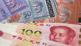 Hunt for next big Asia currency trade lands on ringgit and yuan