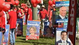 Banners and placards are seen displayed outside a polling station in the suburban seat of Bennelong