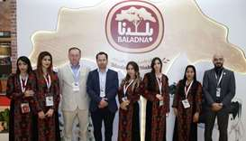 Baladna CEO John Joseph Dore (3rd from left) and his staff at their company's pavilion at Made in Qa