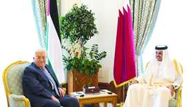 His Highness the Emir Sheikh Tamim bin Hamad al-Thani and the President of Palestine Mahmoud Abbas h