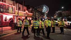 Police officers patrol the area around Old Trafford stadium