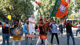Supporters of India's ruling Bharatiya Janata Party (BJP) celebrate outside the party headquarters