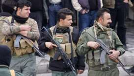 Iraqi Kurdish security forces stand guard