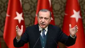 Turkish President Tayyip Erdogan speaks during a ceremony in Ankara