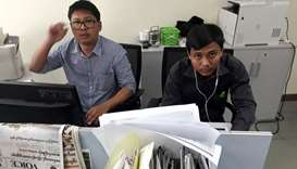 Reuters journalists Wa Lone (L) and Kyaw Soe Oo, who are based in Myanmar, pose for a picture at the