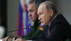 Russian President Vladimir Putin and Defence Minister Sergei Shoigu attend a meeting of Russia's top