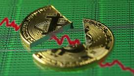 Bitcoin plunges below $12,000, heads for worst week since 2013