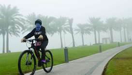 A lone cyclist braves the fog during a ride through the MIA Park