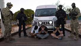 Australian Federal Police SWAT officers watching over suspects after 1.2 tonnes of methamphetamine c