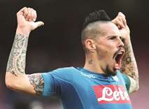 Hamsik passes Maradona's mark as Napoli stay on top