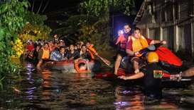 Rescue workers evacuate flood-affected residents in Davao