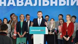 Russian opposition leader Alexey Navalny delivers a speech during a meeting with his supporters in M
