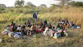 A group of South Sudanese refugees fleeing from recent fighting in Lasu in South Sudan