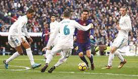 Messi deals with Madrid again as Barca look impregnable