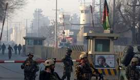 Afghan security forces keep watch at a check point close to compound in Afghanistan