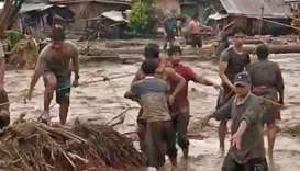 People attempt to rescue flood victims in Lanao Del Norte, Philippines.