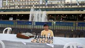 A chess player looks at the board during a game