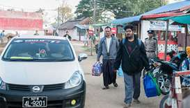 Myanmar freelance journalist Aung Naing Soe (centre R) and driver Hla Tin (centre L) walk out after