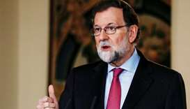 Spain's Prime Minister Mariano Rajoy gestures while delivering his year-end speech at the Moncloa Pa