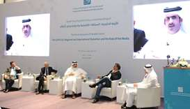 Qatar Media Corporation CEO Sheikh Abdurrahman bin Hamad al-Thani explaining a point as others look