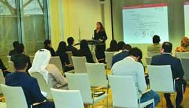 Anna Klapper speaks to participants at a recent Welcome Chinese training in Doha.