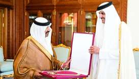Emir presents Hamad bin Khalifa Sash to former speaker of the Advisory Council Mohamed bin Mubarak A