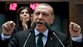 Recep Tayyip Erdogan, gestures as he gives a speech during an AK party's group meeting at the Grand
