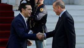 Erdogan, in Greece, says border treaty unclear