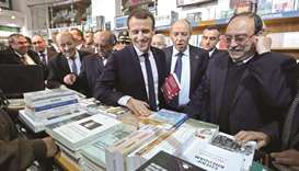 Macron says time to move on from Algeria's colonial past