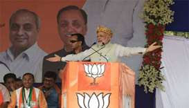 Modi fights to protect home base in election