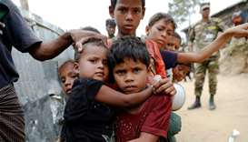 Rohingya refugees wait for cooked food to be distributed at Tengkhali camp near Cox's Bazar, Banglad
